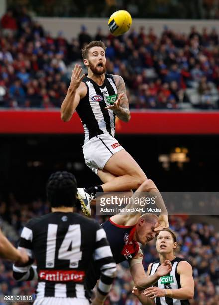 Jeremy Howe of the Magpies marks the ball over Tom McDonald of the Demons during the 2017 AFL round 12 match between the Melbourne Demons and the...
