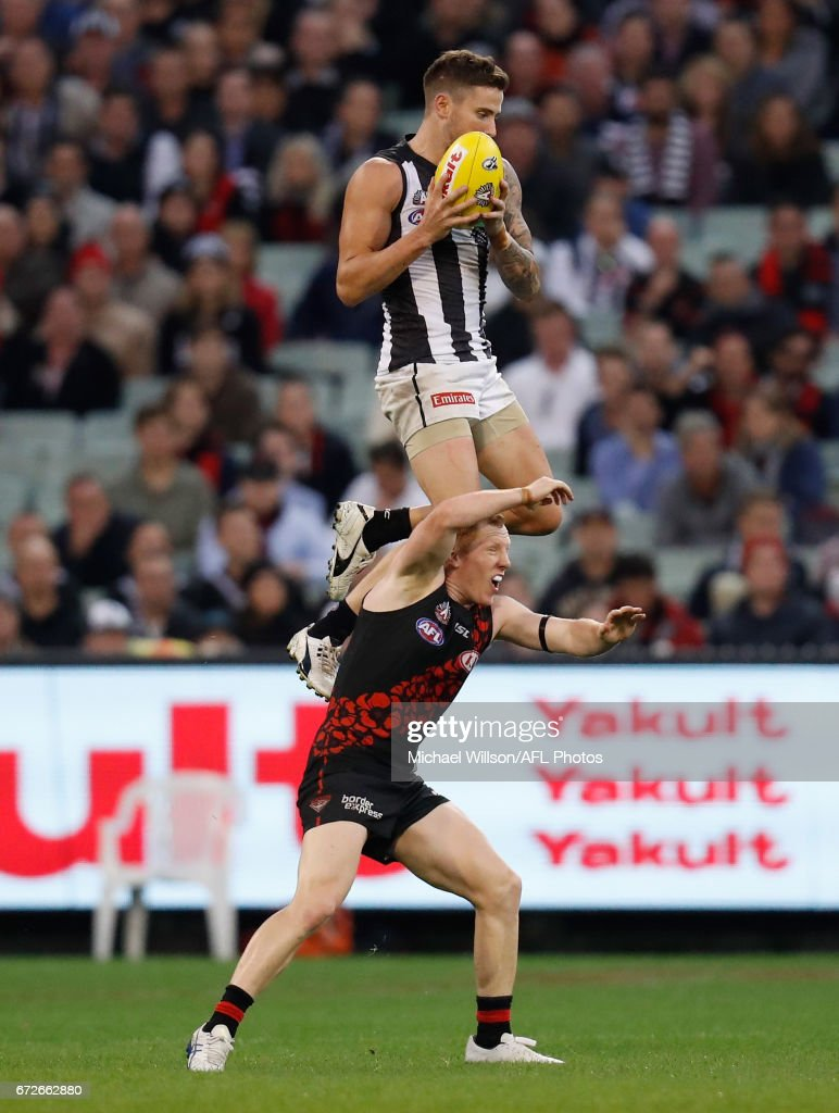 Jeremy Howe of the Magpies takes a spectacular mark over Josh Green of the Bombers during the 2017 AFL round 05 ANZAC Day match between the Essendon Bombers and the Collingwood Magpies at the Melbourne Cricket Ground on April 25, 2017 in Melbourne, Australia.