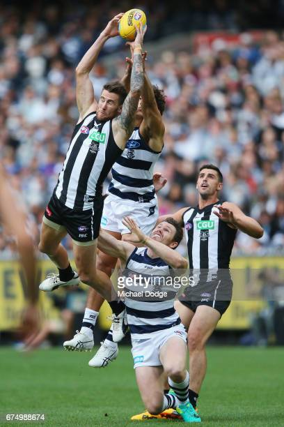 Jeremy Howe of the Magpiesmarks the ball over Patrick Dangerfield of the Cats during the round six AFL match between the Geelong Cats and the...