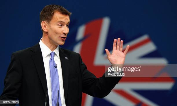 Jeremy Hunt British Secretary of State for Health addresses delegates at the annual Conservative Party Conference in Manchester northwest England on...