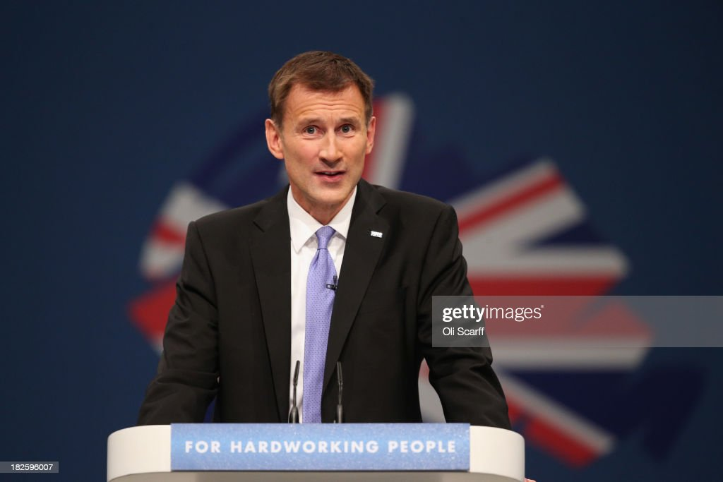 Jeremy Hunt, the Secretary of State for Health, delivers his speech in the Main Hall of Manchester Central on the third day, and penultimate day, of the Conservative Party Conference on October 1, 2013 in Manchester, England. David Cameron has unveiled a Government pilot scheme for GP surgeries to open from 8am until 8pm seven days, backed by 50 million GBP of funding.