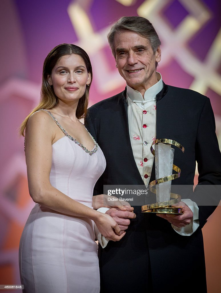 Jeremy Irons holding his award, poses with Laetitia Casta during te Tribute to Jeremy Irons as part of the 14th Marrakech International Film Festival December 6, 2014 in Marrakech, Morocco.