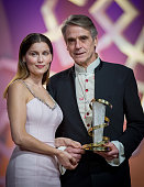Jeremy Irons holding his award poses with Laetitia Casta during te Tribute to Jeremy Irons as part of the 14th Marrakech International Film Festival...