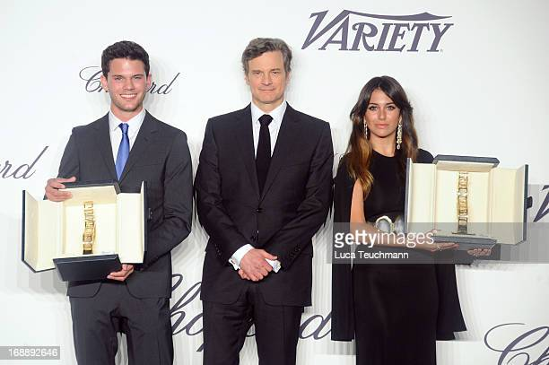 Jeremy Irvine and Blanca Suarez pose with their awards and Chopard Trophy patron Colin Firth during the Chopard Trophy event during the 66th Annual...