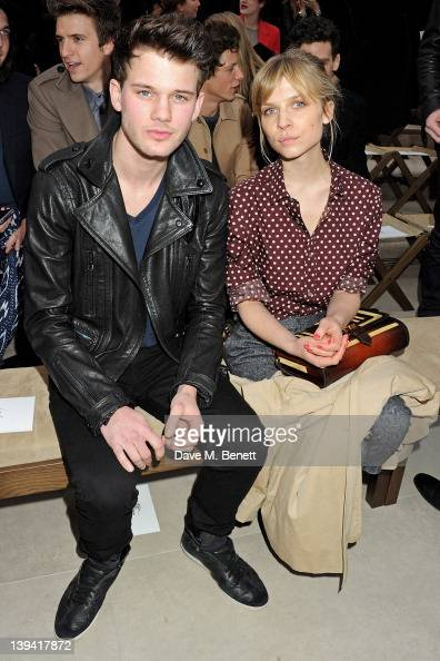 Jeremy Irvine and Clemence Poesy attend the Burberry Autumn Winter 2012 Womenswear Front Row during London Fashion Week at Kensington Gardens on...