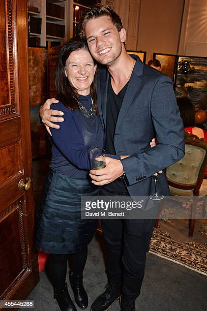 Jeremy Irvine and mother Bridget Smith attend The London 2014 Stella McCartney Green Carpet Collection during London Fashion Week at The Royal...