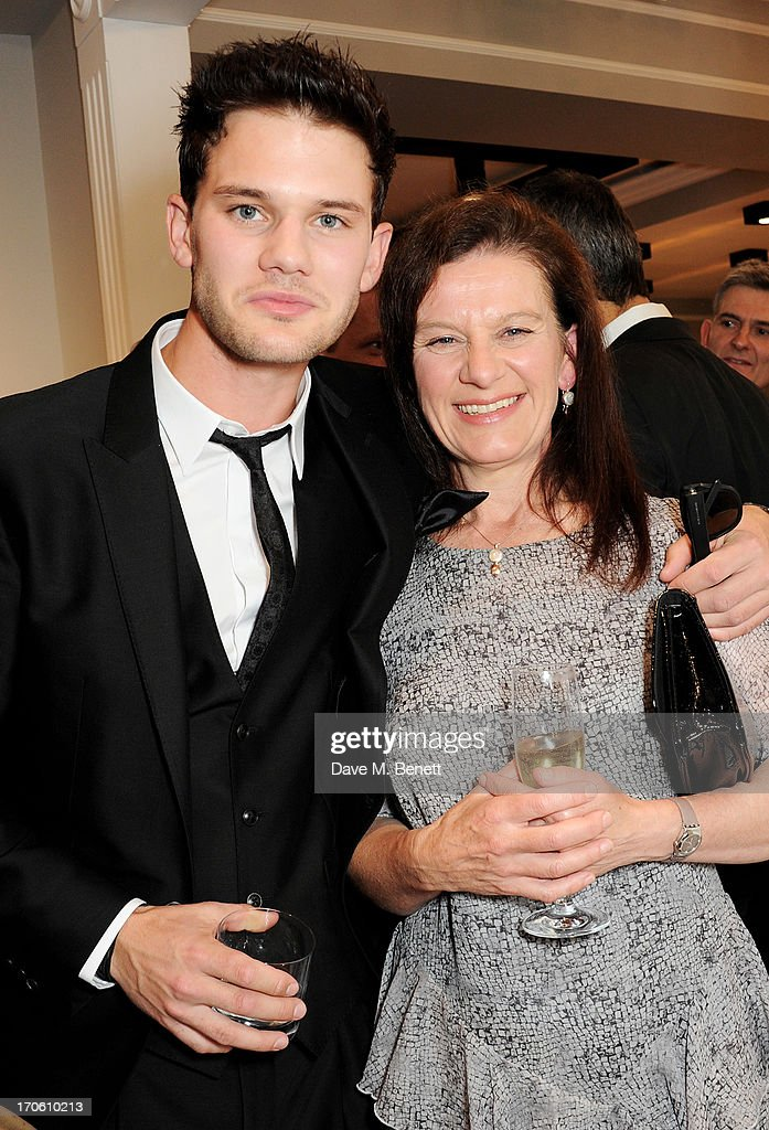 Jeremy Irvine (L) and mother Bridget Smith attend the opening of the new Dolce & Gabbana men's store with a preview of the Summer 2014 Tailoring Collection at Dolce & Gabbana on June 15, 2013 in London, England.