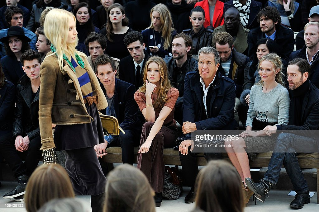 Jeremy Irvine, Eddie Redmayne, Rosie Huntington-Whiteley, Mario Testino and Kate Bosworth attend the Burberry Autumn Winter 2012 Womenswear Front Row during London Fashion Week at Kensington Gardens on February 20, 2012 in London, England.