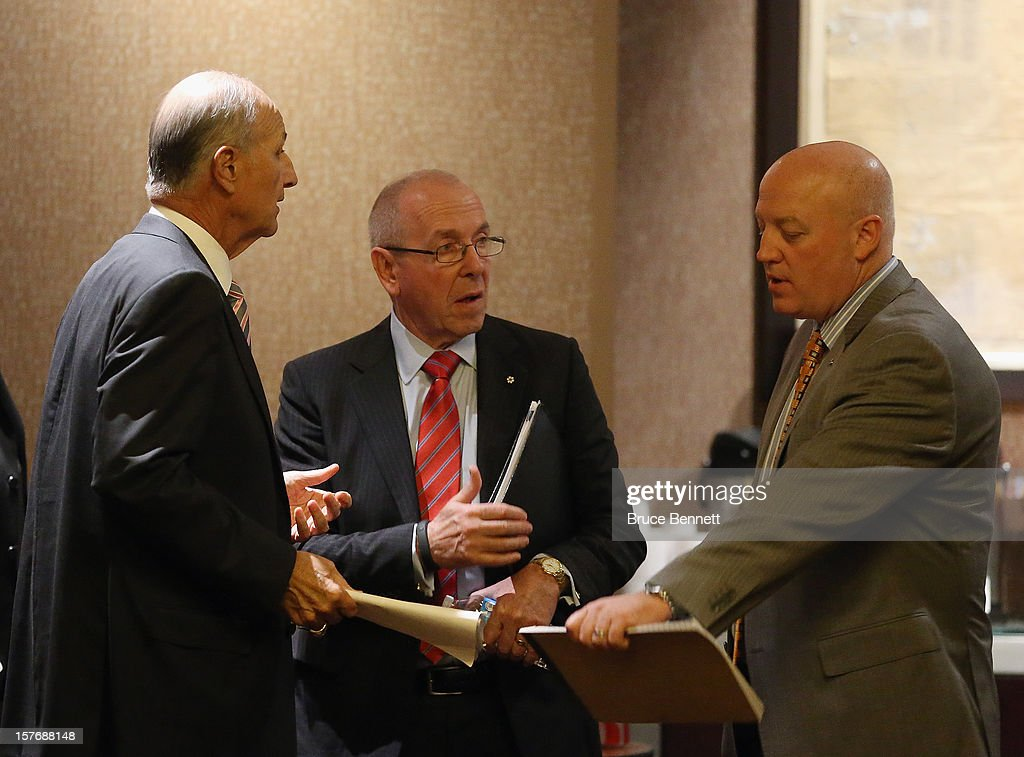 Jeremy Jacobs of the Boston Bruins, Larry Tanenbaum of the Toronto Maple Leafs and Bill Daly of the NHL discuss negotiations at the Westin Times Square on December 5, 2012 in New York City.