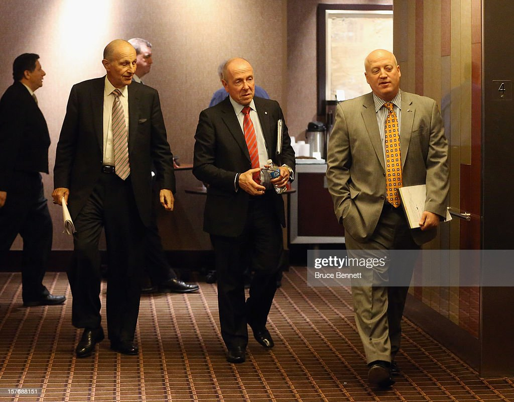 Jeremy Jacobs of the Boston Bruins, Larry Tanenbaum of the Toronto Maple Leafs and Bill Daly of the NHL proceed to negotiations with the NHL Players Association at the Westin Times Square on December 5, 2012 in New York City.