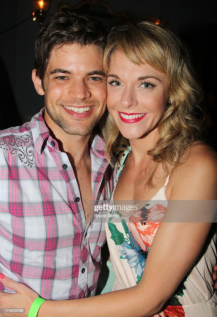 Jeremy Jordan and wife Ashley Spencer pose at the wrap party for the film 'The Last 5 Years' at T.G. Whitney's on July 18, 2013 in New York City.