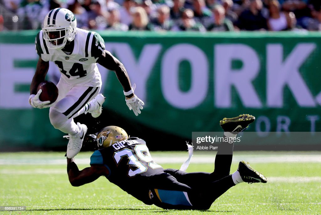 Jeremy Kerley #14 of the New York Jets jumps over Tashaun Gipson #39 of the Jacksonville Jaguars in the second half during their game at MetLife Stadium on October 1, 2017 in East Rutherford, New Jersey.
