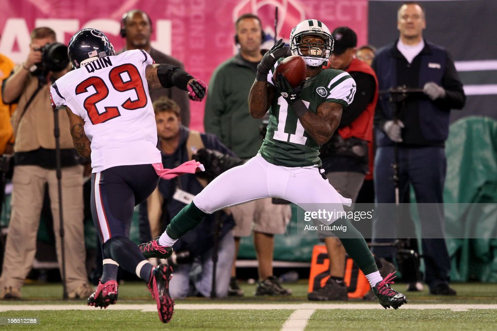 <a gi-track='captionPersonalityLinkClicked' href=/galleries/search?phrase=Jeremy+Kerley&family=editorial&specificpeople=4779050 ng-click='$event.stopPropagation()'>Jeremy Kerley</a> #11 of the New York Jets makes a catch against <a gi-track='captionPersonalityLinkClicked' href=/galleries/search?phrase=Glover+Quin&family=editorial&specificpeople=5732643 ng-click='$event.stopPropagation()'>Glover Quin</a> #29 of the Houston Texans at MetLife Stadium on October 8, 2012 in East Rutherford, New Jersey.