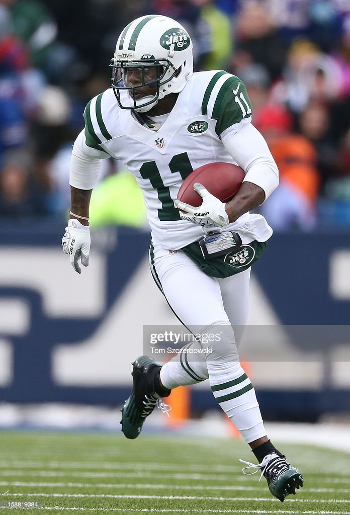 Jeremy Kerley #11 of the New York Jets runs after the catch during an NFL game against the Buffalo Bills at Ralph Wilson Stadium on December 30, 2012 in Orchard Park, New York.
