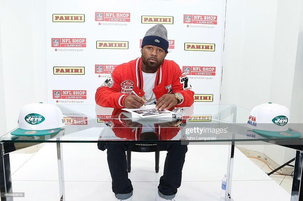 Jeremy Kerley of the New York jets signs copies of Charles Fazzino's 'Super Bowl XLVIII - NY/NJ' Poster at Macy's Herald Square on January 30, 2014 in New York City.