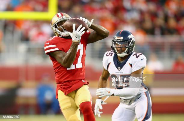 Jeremy Kerley of the San Francisco 49ers catches the ball while covered by Chris Harris Jr #25 of the Denver Broncos at Levi's Stadium on August 19...