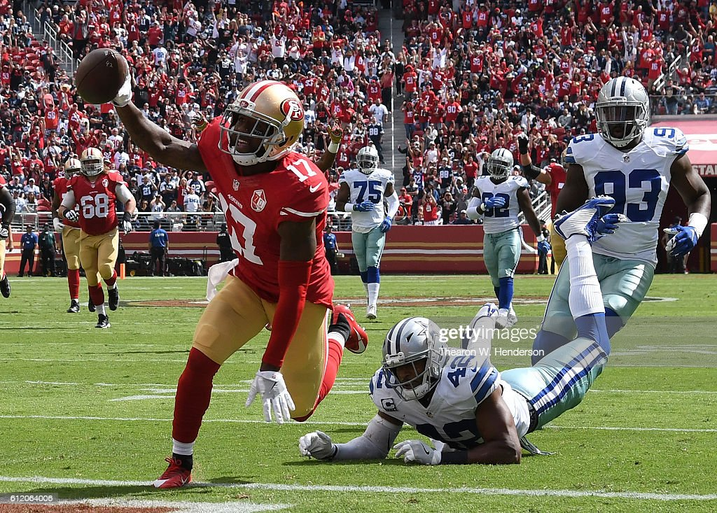 Jeremy Kerley #17 of the San Francisco 49ers crosses the goal line for a touchdown after catching a pass against the Dallas Cowboys at Levi's Stadium on October 2, 2016 in Santa Clara, California.