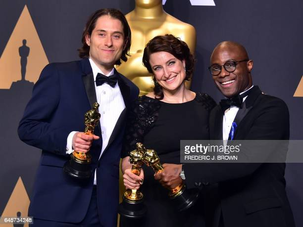 TOPSHOT Jeremy Kleiner Adele Romanski and Barry Jenkins pose in the press room with the Oscar for Best Picture during the 89th Annual Academy Awards...