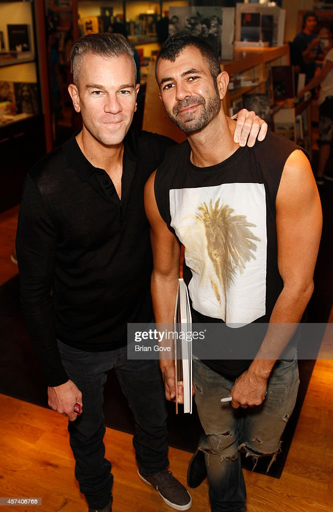 Jeremy Kost with Josh Reed at Jeremy Kost's Book Launch Party For 'Fractured' at BookMarc on October 17 2014 in Los Angeles California