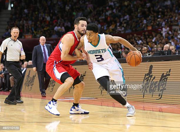 Jeremy Lamb of the Charlotte Hornets drives against JJ Redick of the Los Angeles Clippers as part of the 2015 NBA Global Games China at the Shenzhen...