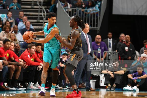 Jeremy Lamb of the Charlotte Hornets handles the ball against Taurean Prince of the Atlanta Hawks during the game between the two teams on October 20...