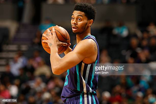 Jeremy Lamb of the Charlotte Hornets looks on during the game against the Philadelphia 76ers during the game at the Time Warner Cable Arena on...