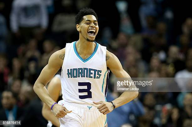 Jeremy Lamb of the Charlotte Hornets reacts after making a basket against the San Antonio Spurs during their game at Time Warner Cable Arena on March...