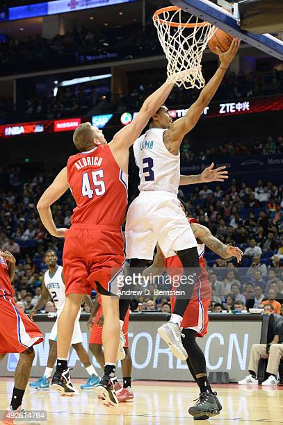 Jeremy Lamb of the Charlotte Hornets shoots against Cole Aldrich of the Los Angeles Clippers as part of the 2015 NBA Global Games China at...