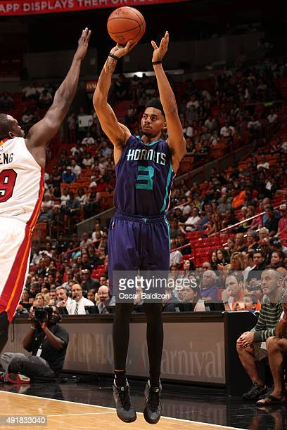 Jeremy Lamb of the Charlotte Hornets shoots the ball against the Miami Heat at the American Airlines Arena in Miami Florida on October 4 2015 NOTE TO...