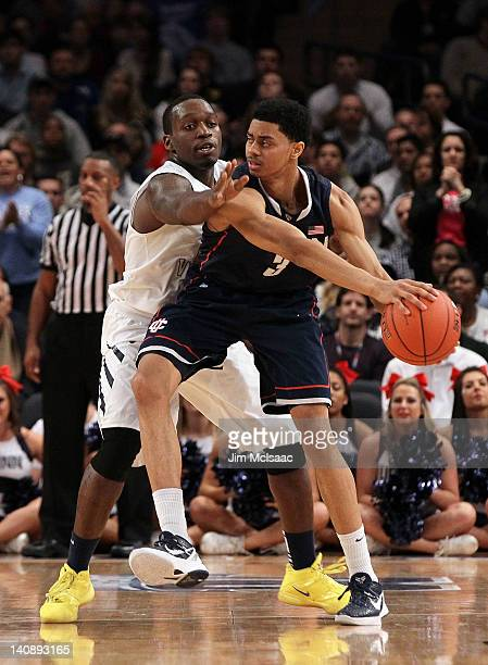 Jeremy Lamb of the Connecticut Huskies controls the ball against Darryl Bryant of the West Virginia Mountaineers during their second round game of...