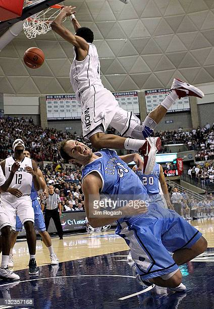 Jeremy Lamb of the Connecticut Huskies dunks the ball as Mark Cisco of the Columbia Lions gets a knee to the face in the second half at Harry A...