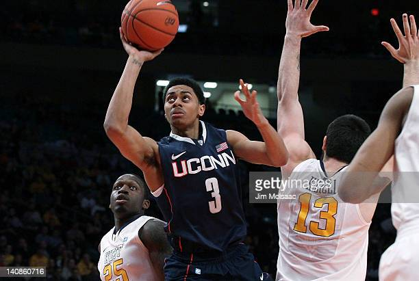 Jeremy Lamb of the Connecticut Huskies puts up a shot against Deniz Kilicli and Darryl Bryant of the West Virginia Mountaineers during their second...