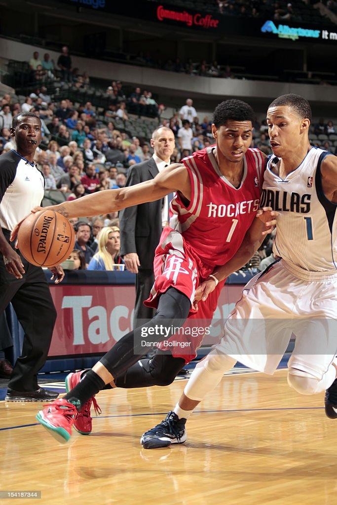 Jeremy Lamb #1 of the Houston Rockets drives against Jared Cunningham #1 of the Dallas Mavericks on October 15, 2012 at the American Airlines Center in Dallas, Texas.