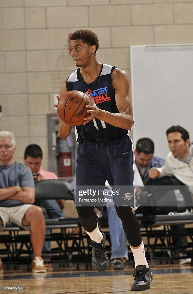 <a gi-track='captionPersonalityLinkClicked' href=/galleries/search?phrase=Jeremy+Lamb&family=editorial&specificpeople=7407506 ng-click='$event.stopPropagation()'>Jeremy Lamb</a> #11 of the Oklahoma City Thunder brings the ball up court during the 2013 Southwest Airlines Orlando Pro Summer League game between the Oklahoma City Thunder and the Houston Rockets on July 12, 2013 at Amway Center in Orlando, Florida.