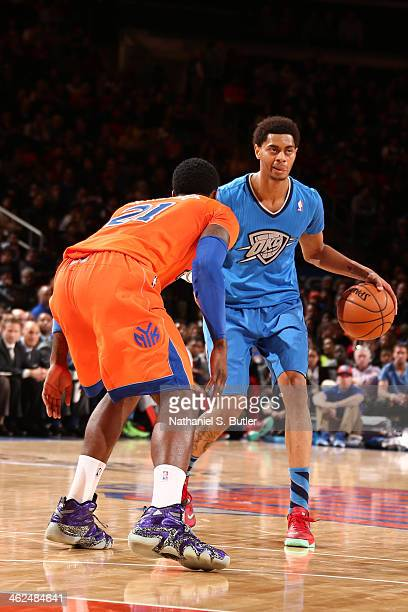 Jeremy Lamb of the Oklahoma City Thunder brings the ball up court against the New York Knicks during a game at Madison Square Garden in New York City...
