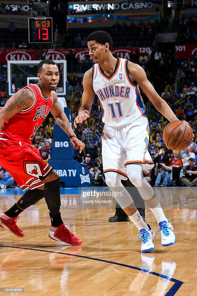 <a gi-track='captionPersonalityLinkClicked' href=/galleries/search?phrase=Jeremy+Lamb&family=editorial&specificpeople=7407506 ng-click='$event.stopPropagation()'>Jeremy Lamb</a> #11 of the Oklahoma City Thunder controls the ball against <a gi-track='captionPersonalityLinkClicked' href=/galleries/search?phrase=Daequan+Cook&family=editorial&specificpeople=3847493 ng-click='$event.stopPropagation()'>Daequan Cook</a> #14 of the Chicago Bulls on February 24, 2013 at the Chesapeake Energy Arena in Oklahoma City, Oklahoma.