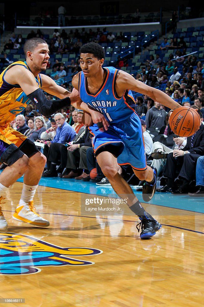 <a gi-track='captionPersonalityLinkClicked' href=/galleries/search?phrase=Jeremy+Lamb&family=editorial&specificpeople=7407506 ng-click='$event.stopPropagation()'>Jeremy Lamb</a> #11 of the Oklahoma City Thunder drives against <a gi-track='captionPersonalityLinkClicked' href=/galleries/search?phrase=Austin+Rivers&family=editorial&specificpeople=7117574 ng-click='$event.stopPropagation()'>Austin Rivers</a> #25 of the New Orleans Hornets on November 16, 2012 at the New Orleans Arena in New Orleans, Louisiana.
