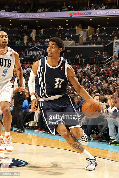 Jeremy Lamb of the Oklahoma City Thunder drives against the Charlotte Bobcats during the game at the Time Warner Cable Arena on December 27 2013 in...