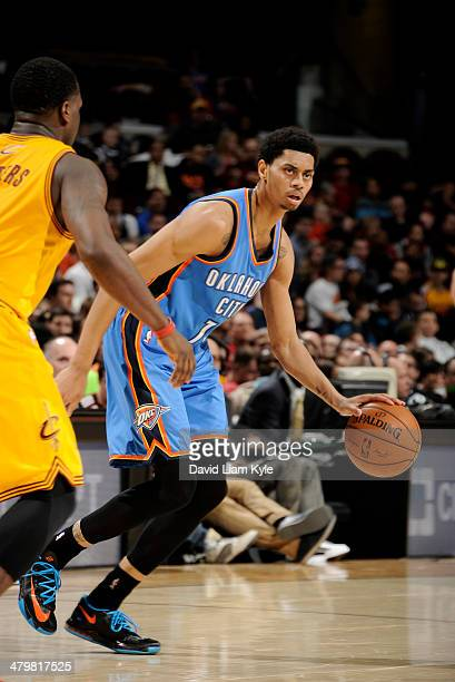 Jeremy Lamb of the Oklahoma City Thunder drives against the Cleveland Cavaliers at The Quicken Loans Arena on March 20 2014 in Cleveland Ohio NOTE TO...