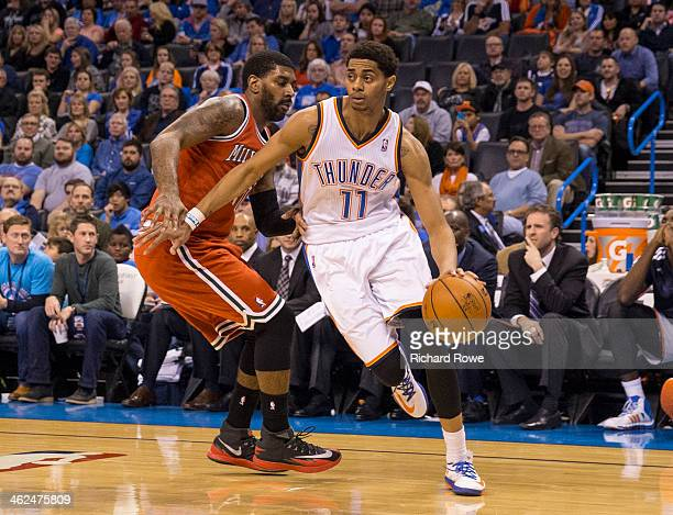 Jeremy Lamb of the Oklahoma City Thunder drives to the basket against the Milwaukee Bucks at the Chesapeake Arena on January 11 2014 in Oklahoma City...