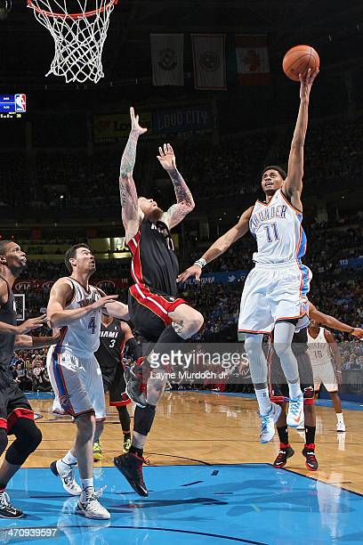Jeremy Lamb of the Oklahoma City Thunder drives to the basket against the Miami Heat during an NBA game on February 20 2014 at the Chesapeake Energy...