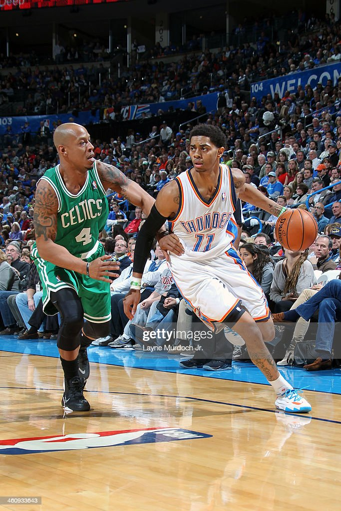 <a gi-track='captionPersonalityLinkClicked' href=/galleries/search?phrase=Jeremy+Lamb&family=editorial&specificpeople=7407506 ng-click='$event.stopPropagation()'>Jeremy Lamb</a> #11 of the Oklahoma City Thunder handles the ball against <a gi-track='captionPersonalityLinkClicked' href=/galleries/search?phrase=Keith+Bogans&family=editorial&specificpeople=202483 ng-click='$event.stopPropagation()'>Keith Bogans</a> #4 of the Boston Celtics on January 5, 2014 at the Chesapeake Energy Arena in Oklahoma City, Oklahoma.