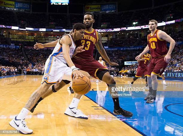Jeremy Lamb of the Oklahoma City Thunder handles the ball against Alonzo Gee of the Cleveland Cavaliers at the Chesapeake Arena on February 26 2014...