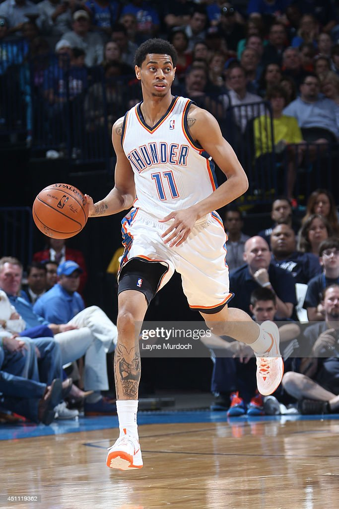 <a gi-track='captionPersonalityLinkClicked' href=/galleries/search?phrase=Jeremy+Lamb&family=editorial&specificpeople=7407506 ng-click='$event.stopPropagation()'>Jeremy Lamb</a> #11 of the Oklahoma City Thunder handles the ball against the Houston Rockets during an NBA game on March 11, 2014 at the Chesapeake Energy Arena in Oklahoma City, Oklahoma.