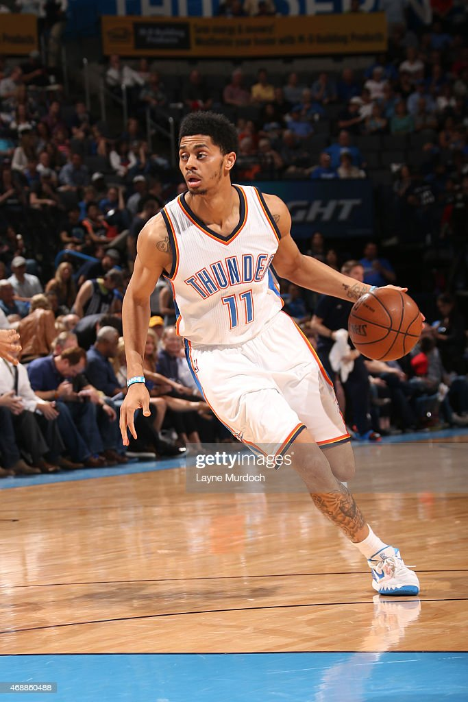 Jeremy Lamb #11 of the Oklahoma City Thunder handles the ball against the San Antonio Spurs on April 7, 2015 at Chesapeake Energy Arena in Oklahoma City, Oklahoma.