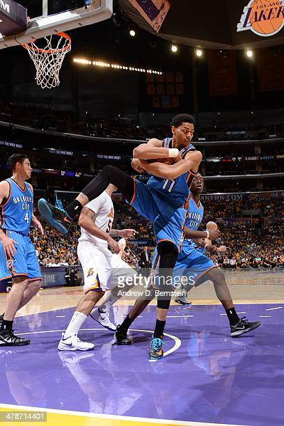 Jeremy Lamb of the Oklahoma City Thunder rebounds against the Los Angeles Lakers at STAPLES Center on March 9 2014 in Los Angeles California NOTE TO...