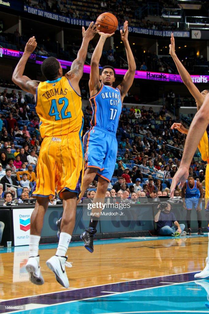 Jeremy Lamb #11 of the Oklahoma City Thunder shoots against Lance Thomas #42 of the New Orleans Hornets on November 16, 2012 at the New Orleans Arena in New Orleans, Louisiana.