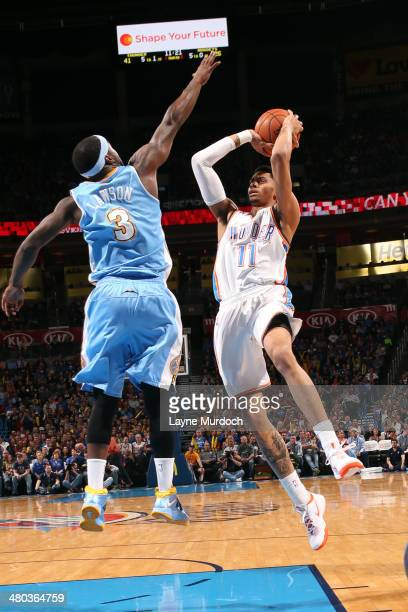 Jeremy Lamb of the Oklahoma City Thunder shoots against the Denver Nuggets on March 24 2014 at the Chesapeake Energy Arena in Oklahoma City Oklahoma...