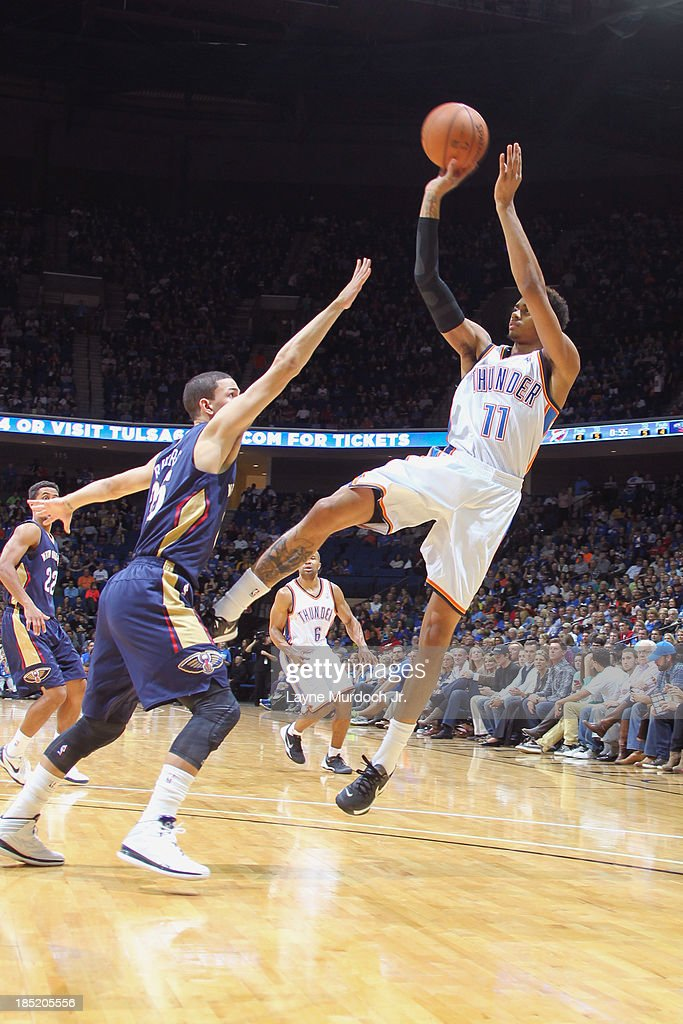 <a gi-track='captionPersonalityLinkClicked' href=/galleries/search?phrase=Jeremy+Lamb&family=editorial&specificpeople=7407506 ng-click='$event.stopPropagation()'>Jeremy Lamb</a> #11 of the Oklahoma City Thunder shoots the ball against the New Orleans Pelicans on October 17, 2013 at the BOK Center in Tulsa, Oklahoma.