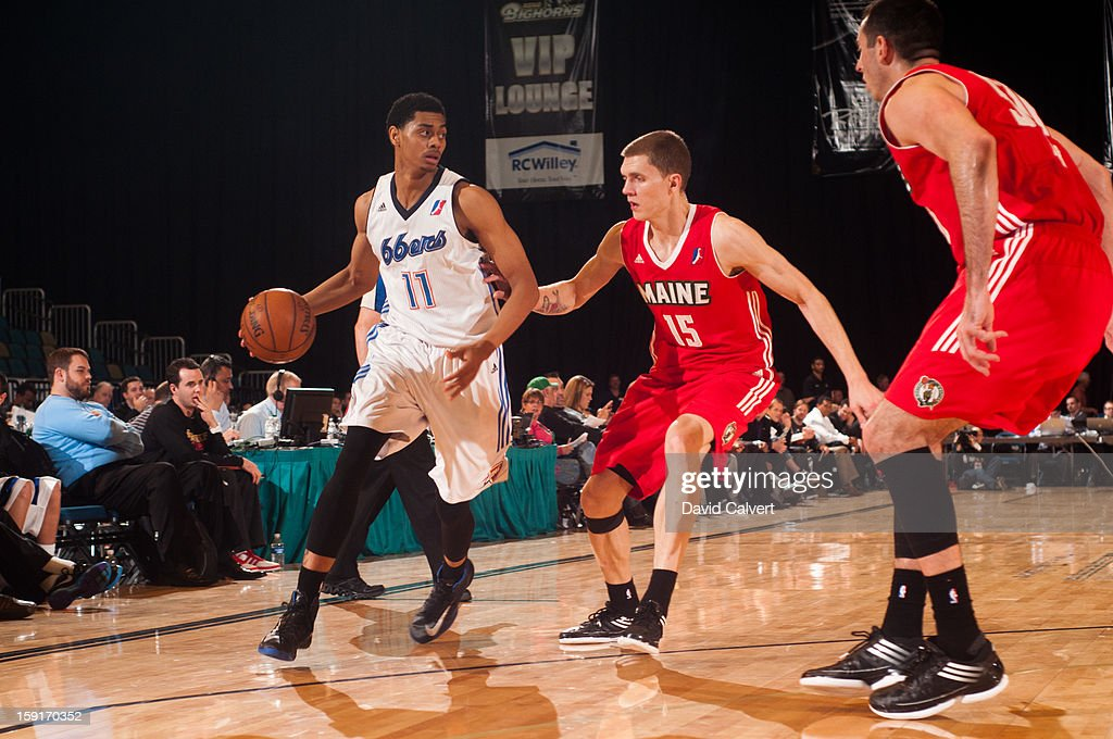 Jeremy Lamb #11 of the Tulsa 66ers dribbles into defenders Micah Downs #15 and Chris Ayer #50 of the Maine Red Claws during the 2013 NBA D-League Showcase on January 7, 2013 at the Reno Events Center in Reno, Nevada.